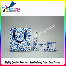 High Quality Fashion Design Coated Paper Cosmetic Bag with Handle