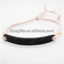 plated black color alloy carved phiz symbol white leather bracelet