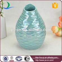 YSv0067-04 Embossed porcelain mini vase with pearlized finishing