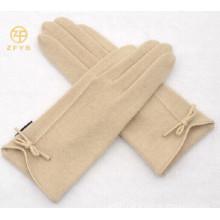 ladies wrist length wearing white wool glove