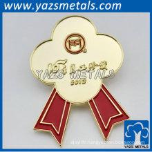 gold flower shaped metal badges for staff