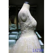 Lanières d'illusion applique florale robe de mariée en tulle
