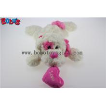 Fábrica de China feita pelúcia branca brinquedo do cão do bebê de mentira com orelha rosa e travesseiro coração Bos1191