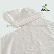 Nonwoven disposable hairdressing towel embossed