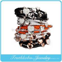Fabricante de pulseira de couro de moda nova rodada pulseira de cordão de couro com palmas de aço inoxidável