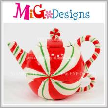 Caneca cerâmica da forma do bule da decoração do Natal