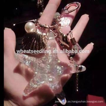Alibaba de moda de las estrellas de mar del diseño cadena dominante cristalina del keychain al por mayor