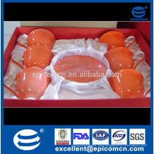 Venta de la promoción como el regalo esmaltó las tazas y los platillos de China del hueso con la etiqueta del fower adentro
