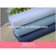 Tejido de algodón de poliéster suave handfeel Oxford Tela modal de diseño liso de la camisa en stock para el uniforme