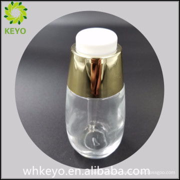 30ml Hot sale clear empty cosmetic glass bottle with press dropper