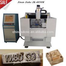 3D гравировка дешевые Китай Цзинань Тя Хэ ЧПУ JK - 4050 М металла