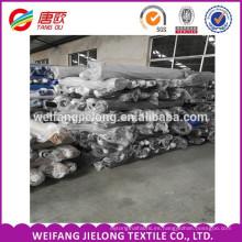 Uniformes y textiles de algodón o tc stock de teñido sólido hecho en China tc tela de sarga para pantalones
