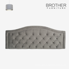 French upholstered bentwood headboard with tufting and nailheads