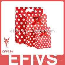 Bolso de embalaje de regalo de lunares rojo y blanco hecho a mano