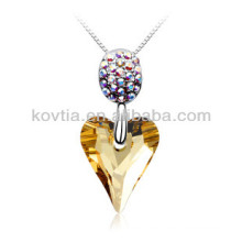 Heart shape natural yellow crystal pendant