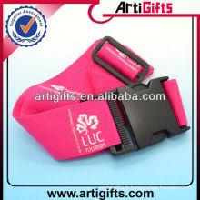 Ceinture à bagages réglable couleur rose