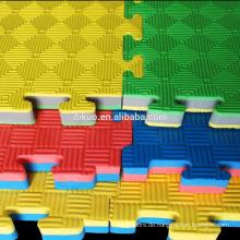 Bunte Puzzlespielkinder Evas spielen Mattsbildungs-Bodenmatte