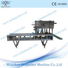 Machine d'étanchéité pour bac d'étanchéité à bande jetable