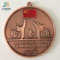 Liefern Sie Logo-Legierungs-Casting-Metall-Taekwondo-Medaillen mit Band besonders an