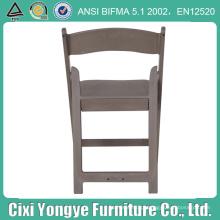 Cadeira dobrável de resina cinza acolchoada para casamentos
