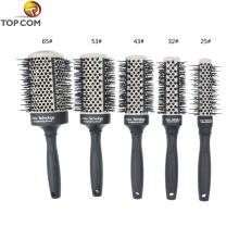 Brosse à cheveux thermique en métal thermal noire ronde avec étiquette privée