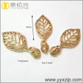 Shiny gold berongga daun logo logam ritsleting slider
