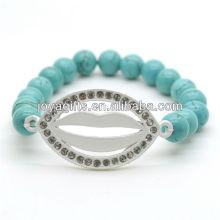 Türkis 8MM runde Perlen Stretch Edelstein Armband mit Diamante Lippe in der Mitte