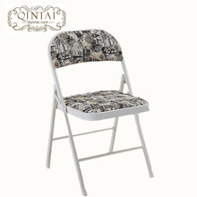 Silla de metal plegable al por mayor con estructura metálica con respaldo de PU y asiento impreso Monroe en muebles plegables en blanco y negro