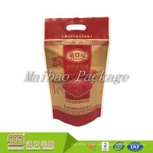 China Hersteller-kundenspezifischer Markenname-Farbentwurf stempelschnitt Griff lamellierte Plastikco-Reis-Tasche für Großverkauf
