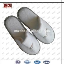 Fabricación del profesional de la garantía del comercio Suministro al por mayor Zapatillas disponibles desechables para el hotel