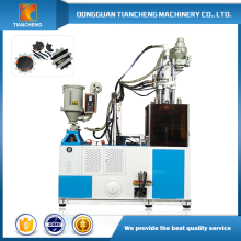 Single slide table vertical injection molding machines