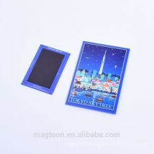 custom wholesale blue color tower design tin plate fridge magnets for super market