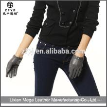 Venta al por mayor de bajo precio de alta calidad de chatarra guantes de cuero