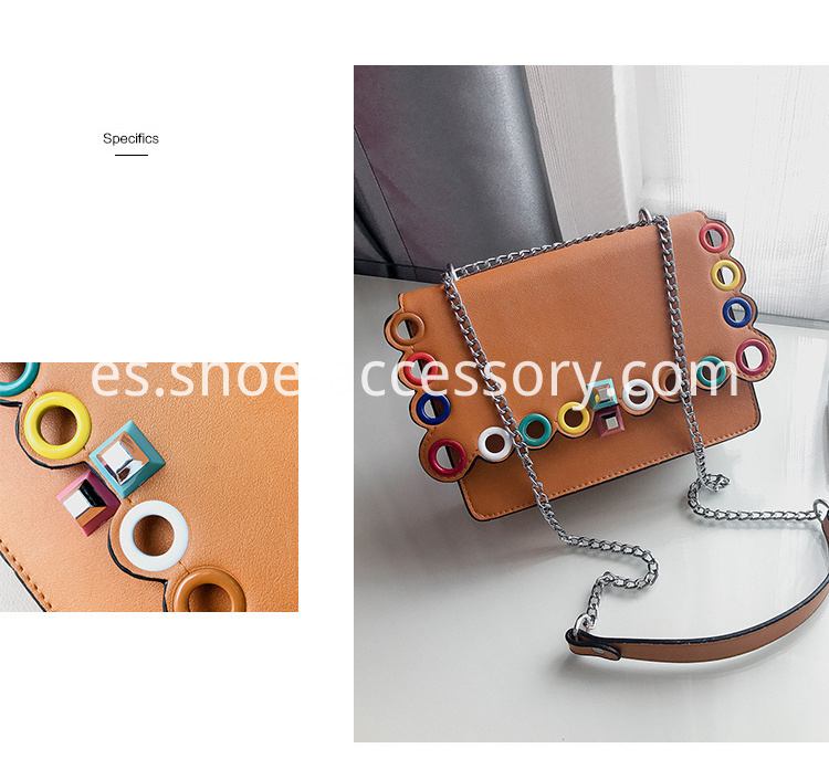 handbag with colored eyelets embellishments