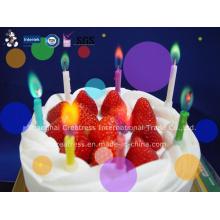 Vela colorida do aniversário da chama da cor para miúdos