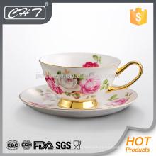 Taza de té de promoción de lujo y platillo al por mayor con mano de oro
