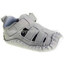 El bebé al por mayor del bebé calza las sandalias lindas de los zapatos de los cabritos