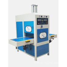 Sliding table high frequency welding and embossing machine