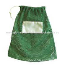 Heavy mesh laundry bags in green color, drawstring closure, each bag is packed in an OPP bag