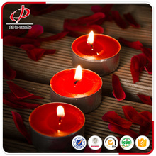 Scented red tealight candles in plastic cup