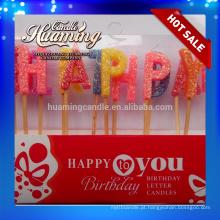 Velas quentes da letra do feliz aniversario da venda