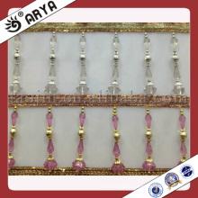 Découpe de franges en perles de rideau
