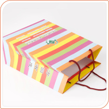 Colour kraft paper gift bags with handles made by machine