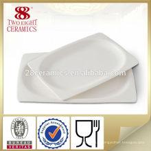 Porcelaine en gros 12 pouces gravés assiettes de vaisselle de porcelaine pour hôtel