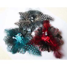 Dekorative Bögen zum Verkauf mit Feder und Perlen