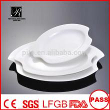 Fabricant porcelaine / banane en céramique plaque à feuilles plaque de poisson plaque de viande plaque ovale