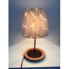 Table lamp with leaf pattern