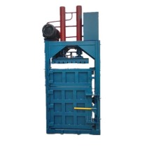 Hydraulic waste material baler machine