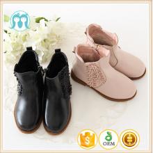 China Großhandelskindschuh Kinderkurzer Stiefelwinter Rosa PU-Mädchen lädt Art und Weise schwarze Aufladungskindschuhe auf
