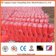 Base de PVC roja utilizada para vallas temporales